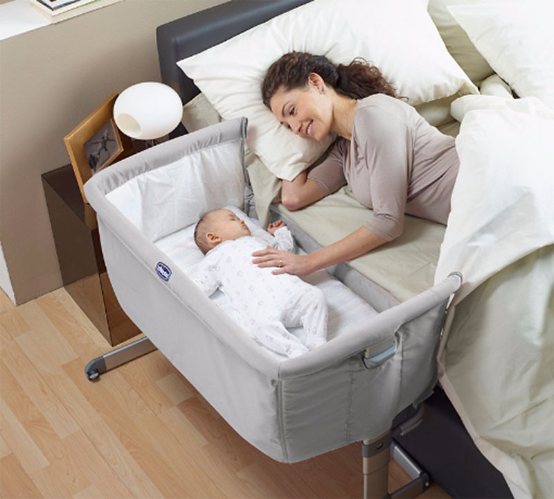 Image of mother and baby using Chicco Next to me crib